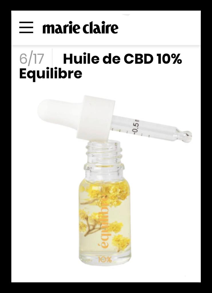 Flacon avec pipette gradué d'huile de CBD Equilibre 10% et fleurs immortelles dans la parution de Marie Claire