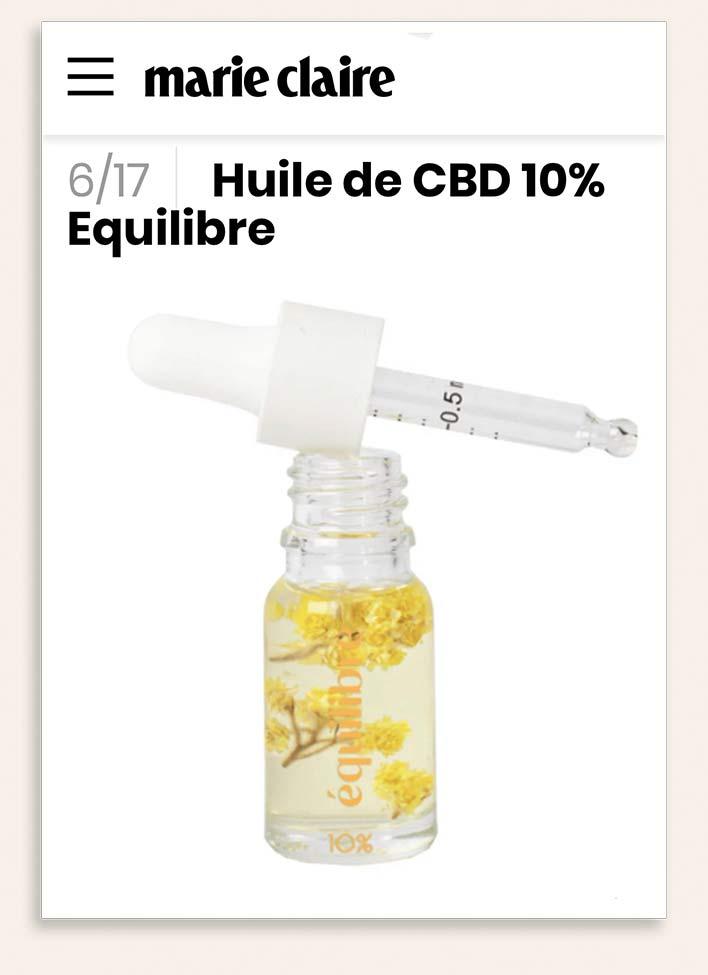 Flacon avec pipette gradué d'huile de CBD Equilibre 10% et fleurs immortelles dans l'article de presse de Marie Claire